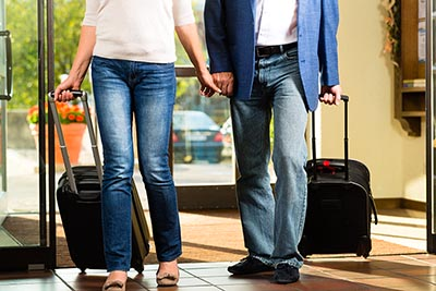 Showing a couple arriving at their holiday destination